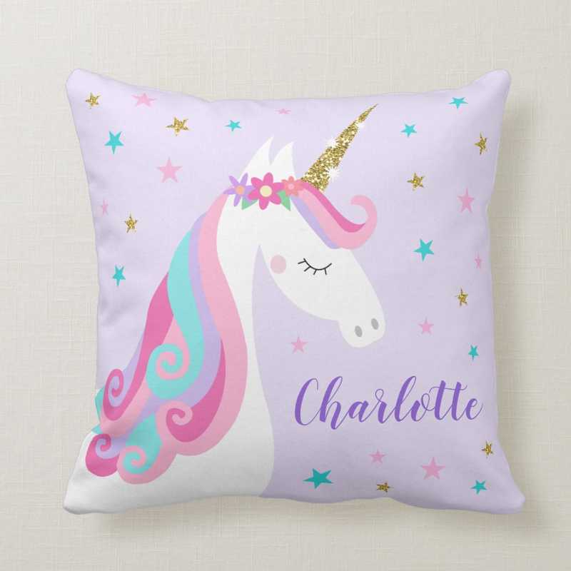 Unicorn pillow with flowers and gold glitter, purple background with stars and personalized name.