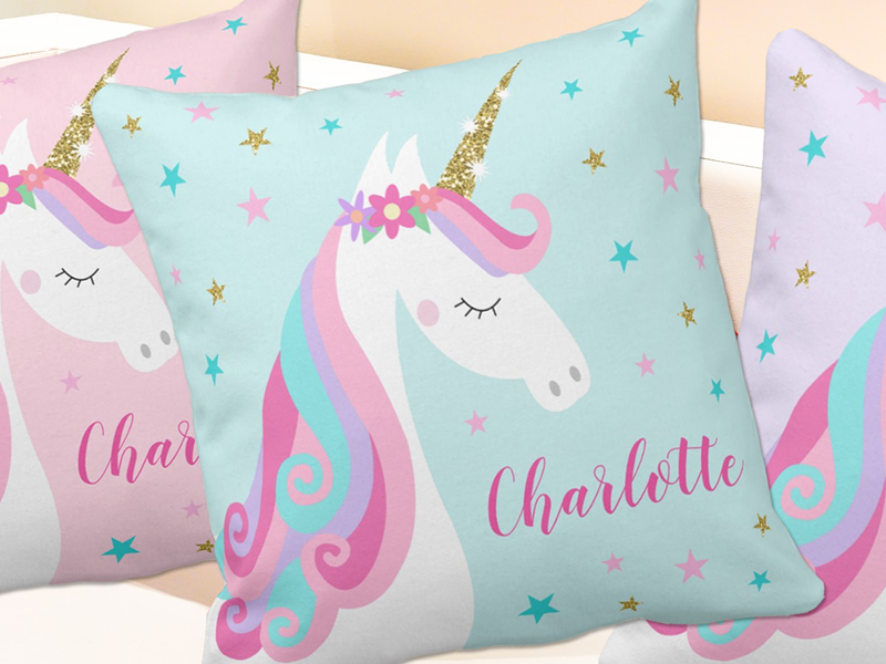 Unicorn pillows with rainbow unicorn, glitter, flowers and stars in aqua, pink and purple.